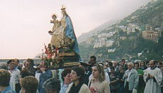 The Madonna is carried in a procession from the sea